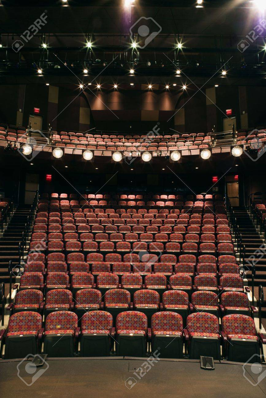Rows Of Empty Seats In Theater Seen From Stage Vertical Shot Stock Photo