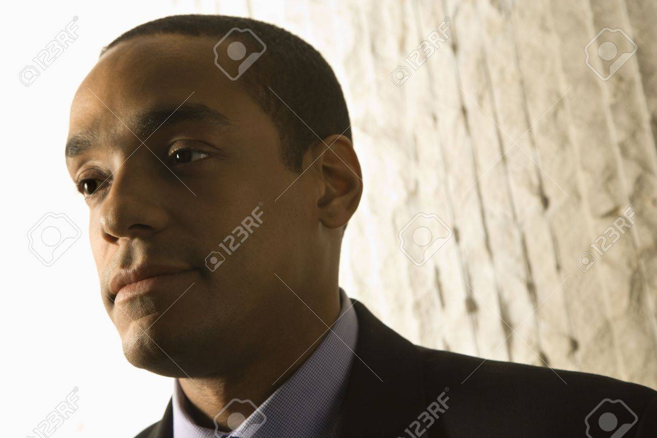 Low angle close-up portrait of serious African-American mid-adult businessman. Horizontal format. Stock Photo - 6455202