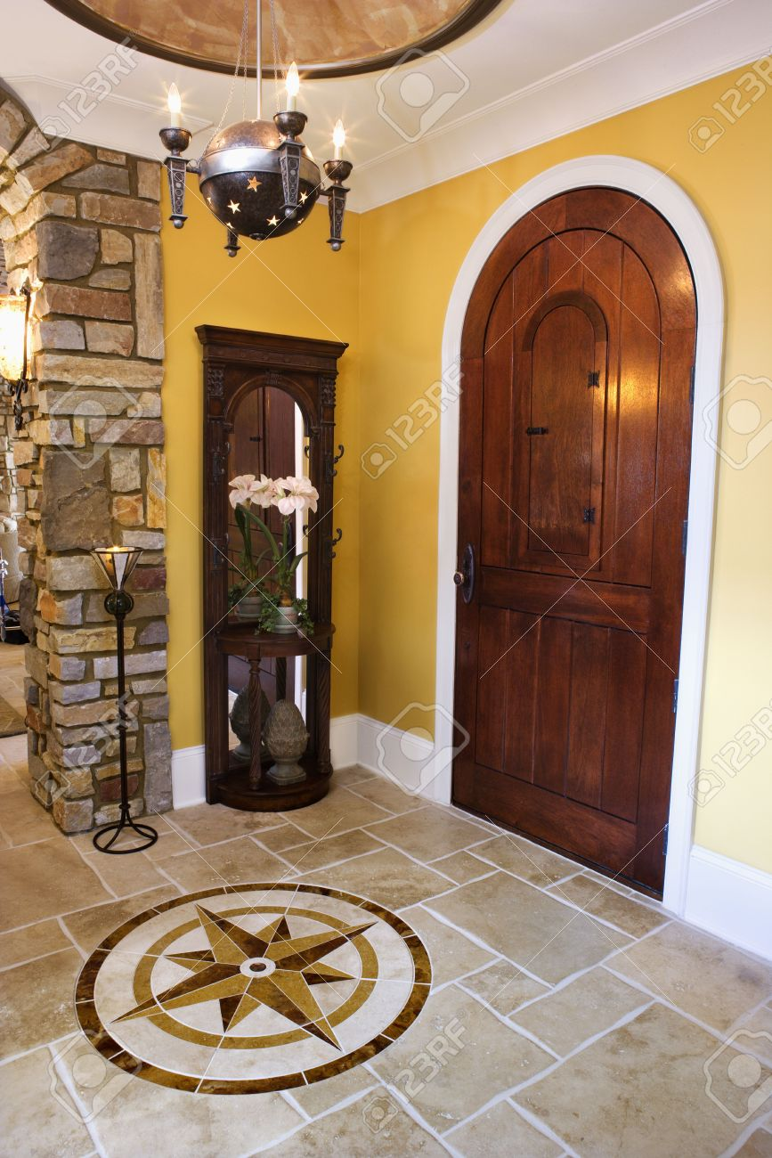 Arched Front Door And Ceramic Tile Entryway Of Luxury Home With ...