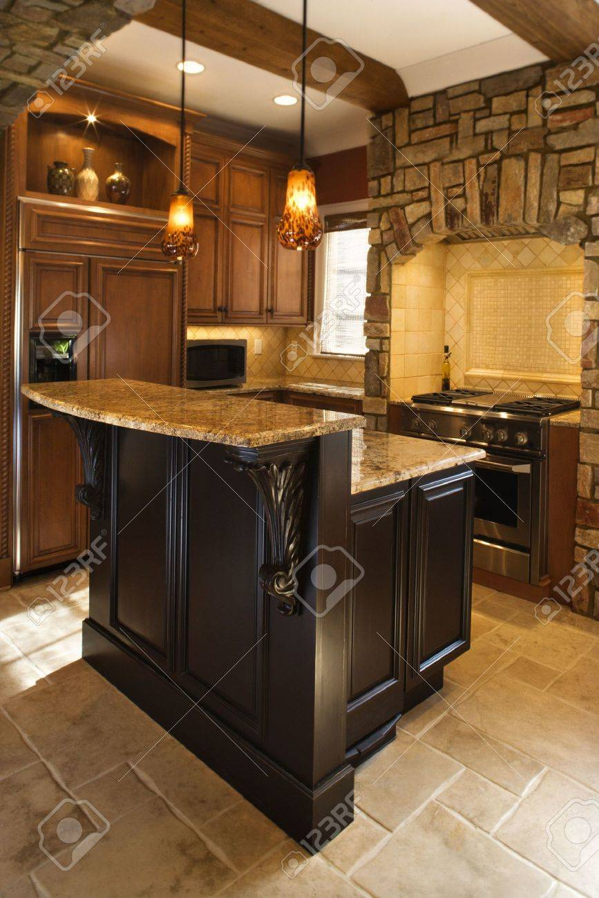 Upscale kitchen interior with stone accents and wood beam ceiling. Vertical shot. Stock Photo - 6468619