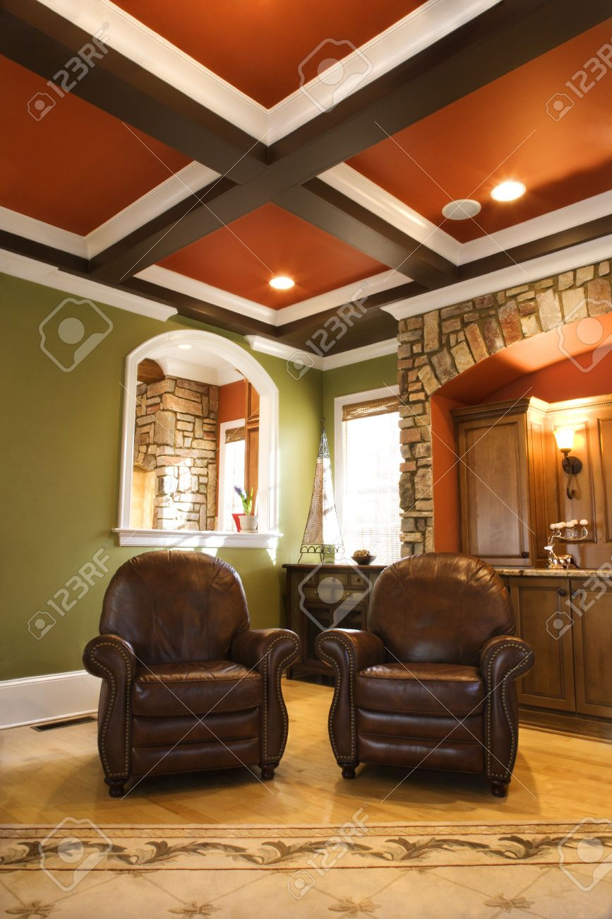 Upscale Living Room Furniture Two Brown Leather Chairs In An Upscale Living Room With Wooden