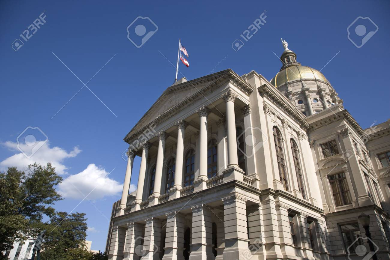 Side entrance to a state capitol building with blue sky and clouds in the background. Horizontal shot. Stock Photo - 6427564
