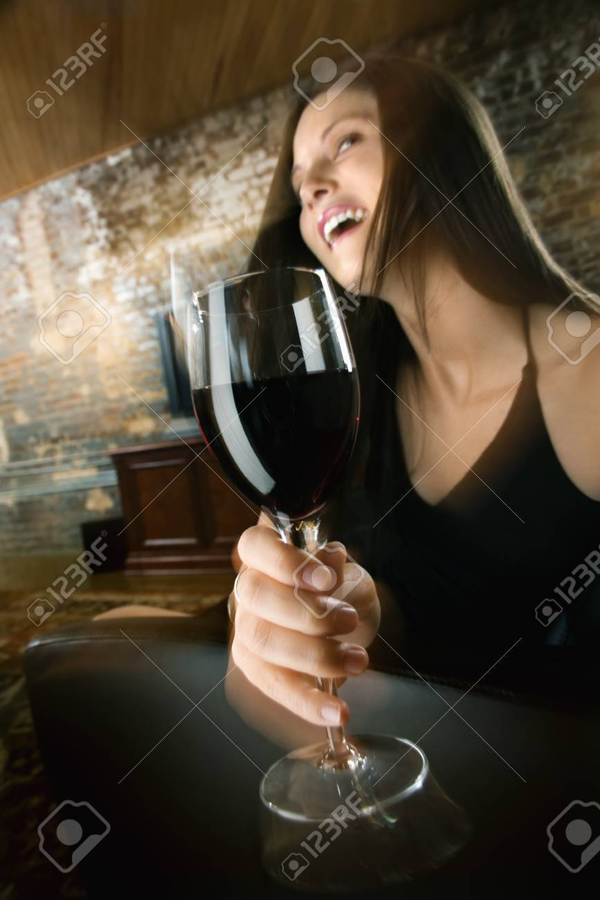 Pretty young Caucasian woman toasting wine glass and laughing. Stock Photo - 6913942