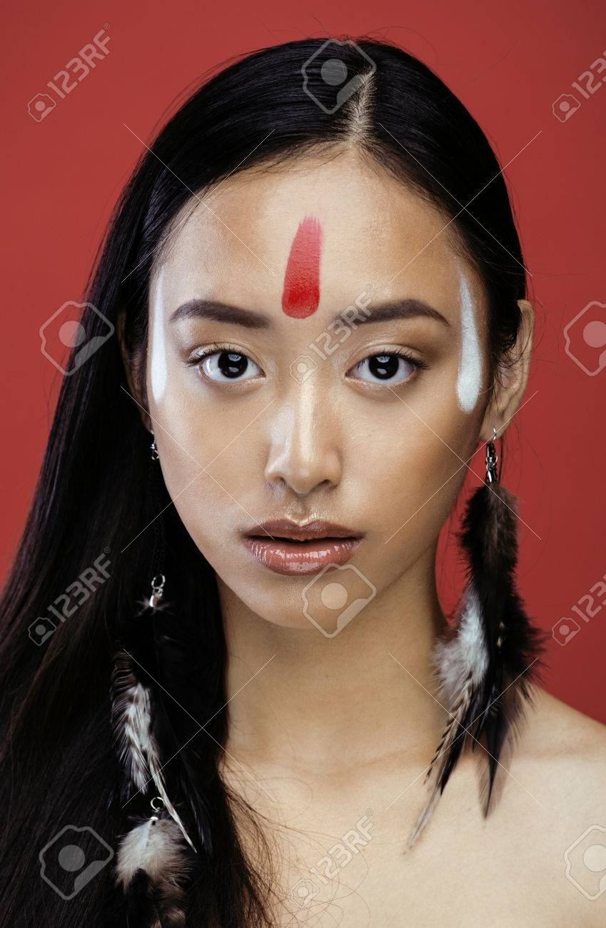 Beauty young asian girl with make up like pocahontas red indians beauty young asian girl with make up like pocahontas red indians woman fashion close baditri Images