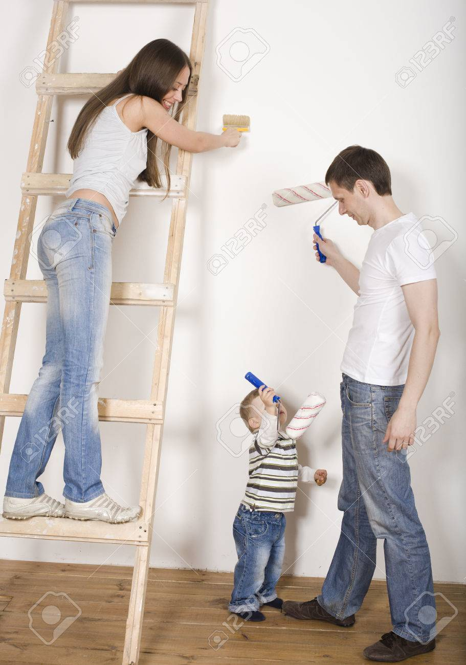 Perfect Portrait Of Happy Family Doing Repair, New House Painting Walls Stock Photo    45219701