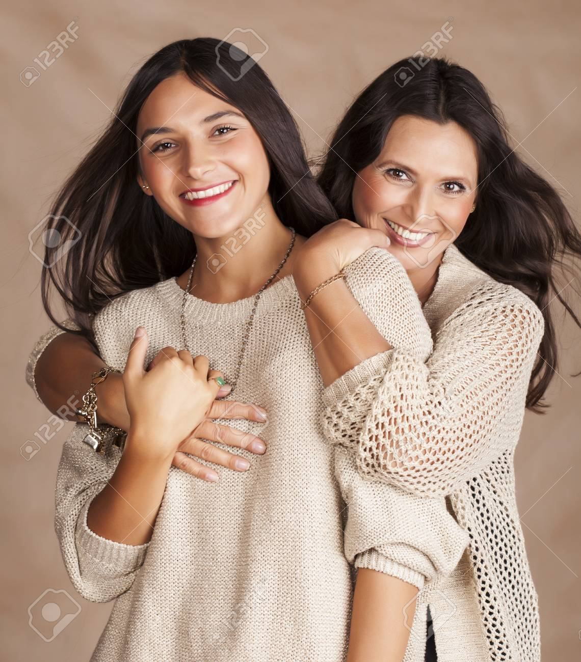 cute pretty teen daughter with mature mother hugging stock photo