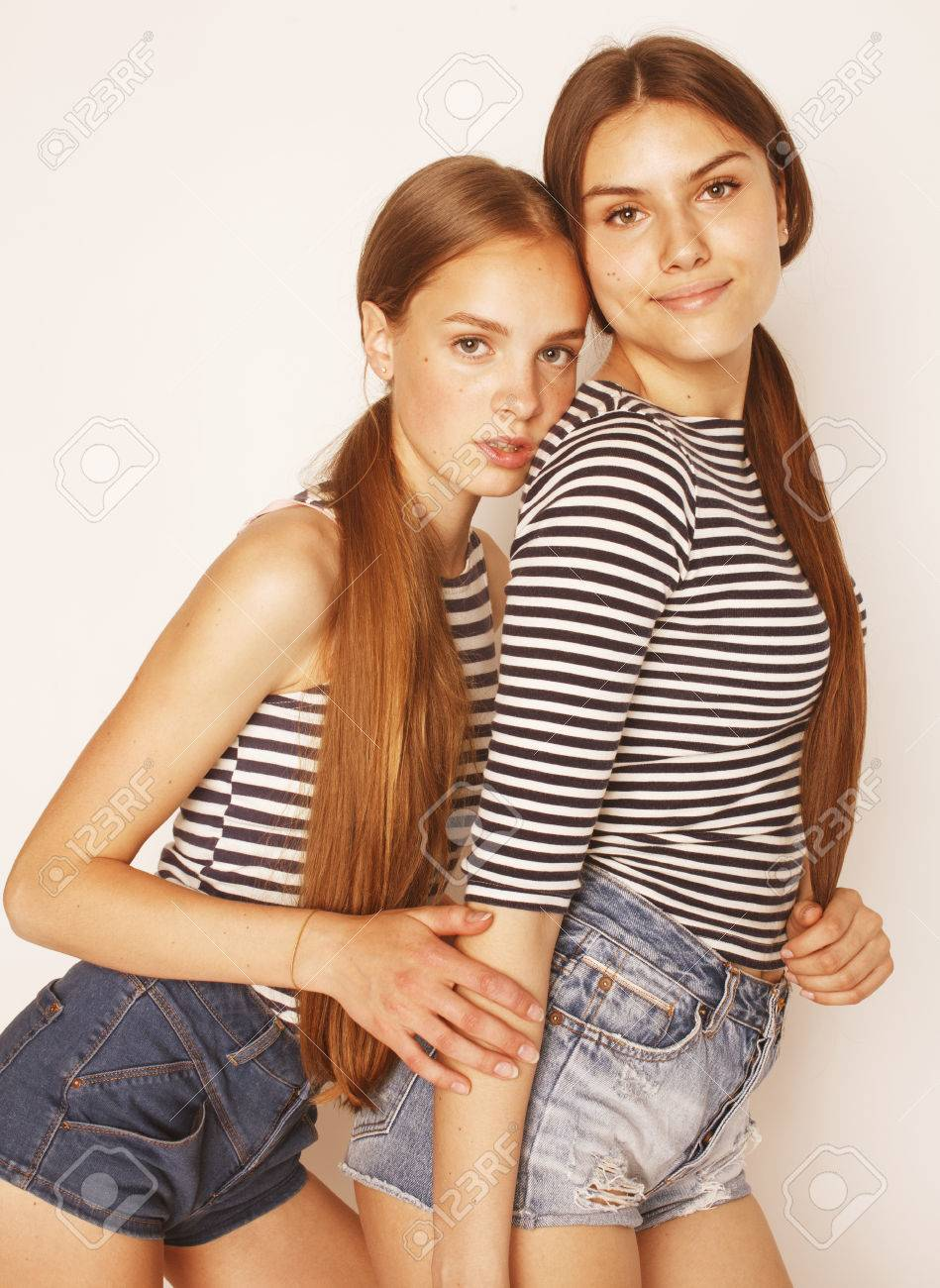 Cute Teenagers two cute teenagers having fun together isolated on white, girls