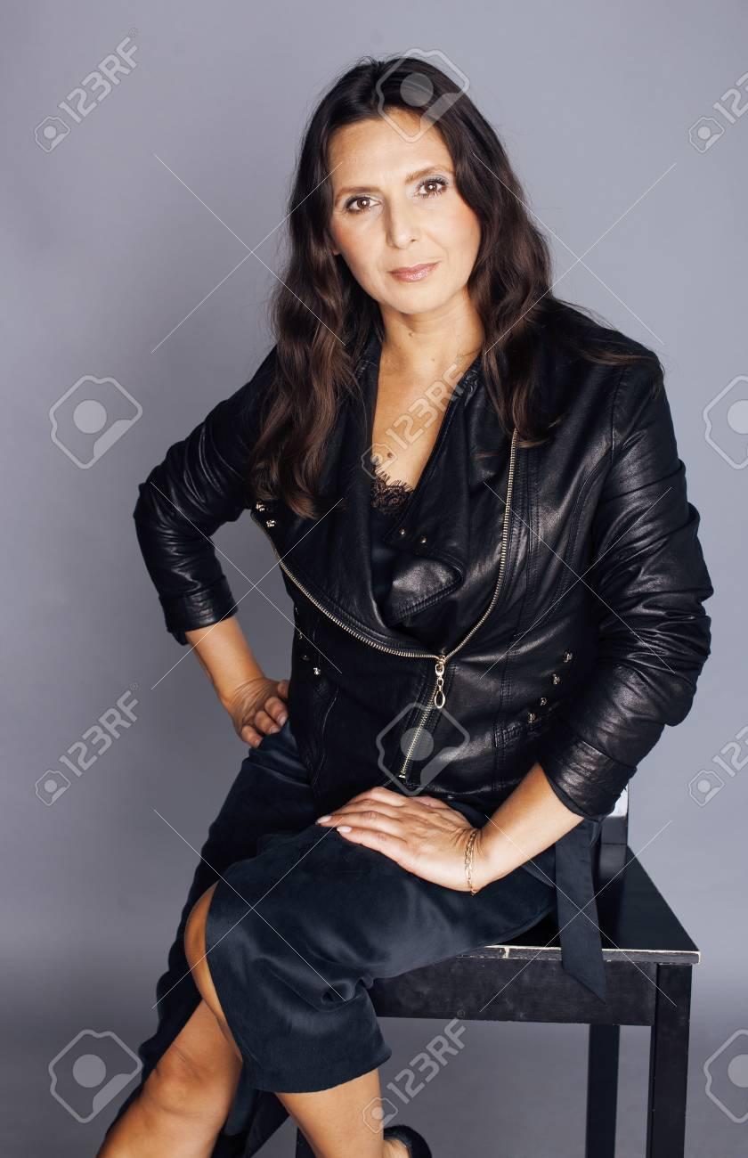 pretty brunette confident stylish real mature woman sitting on