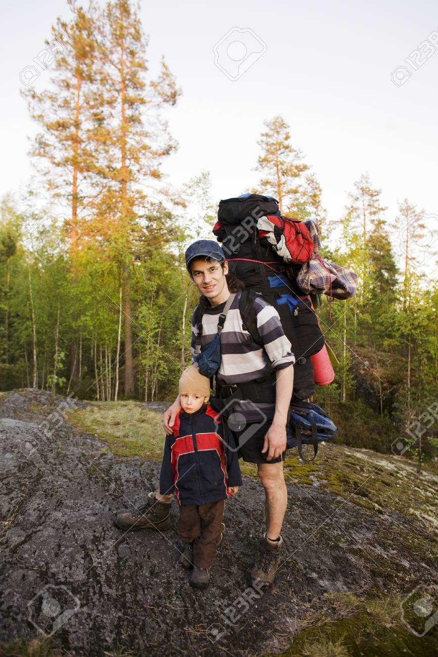 a0b963f1c452 Stock Photo - young happy father traveling with little son and huge backpack