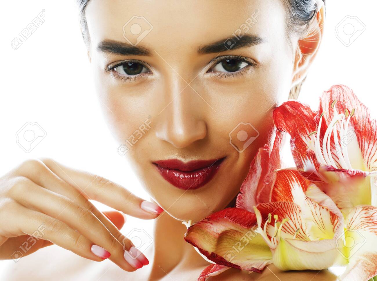 young pretty brunette real woman with red flower amaryllis - 128614970