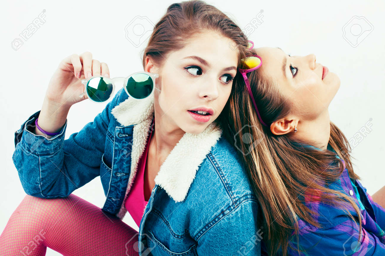 two best friends teenage girls together having fun, posing emotional on white background, besties happy smiling, making selfie, lifestyle people concept - 125378561