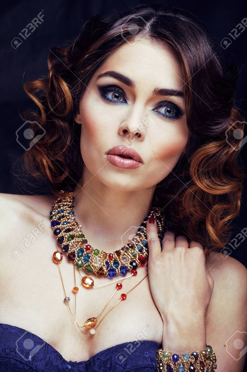beauty rich woman with bright makeup wearing luxury jewellery looks like mature close up, fashion lady curly hairstyle - 128554793