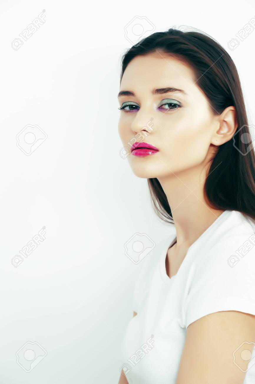 young pretty teenage girl posing emotional happy smiling on white background, lifestyle people concept - 130610260