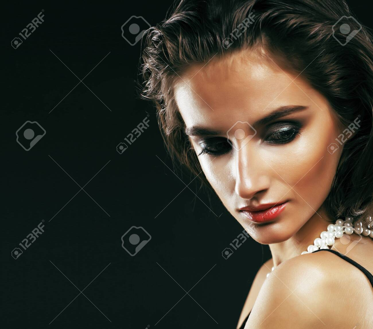 beauty rich woman with bright makeup wearing luxury jewellery on black background, fashion lady curly hairstyle - 140602456