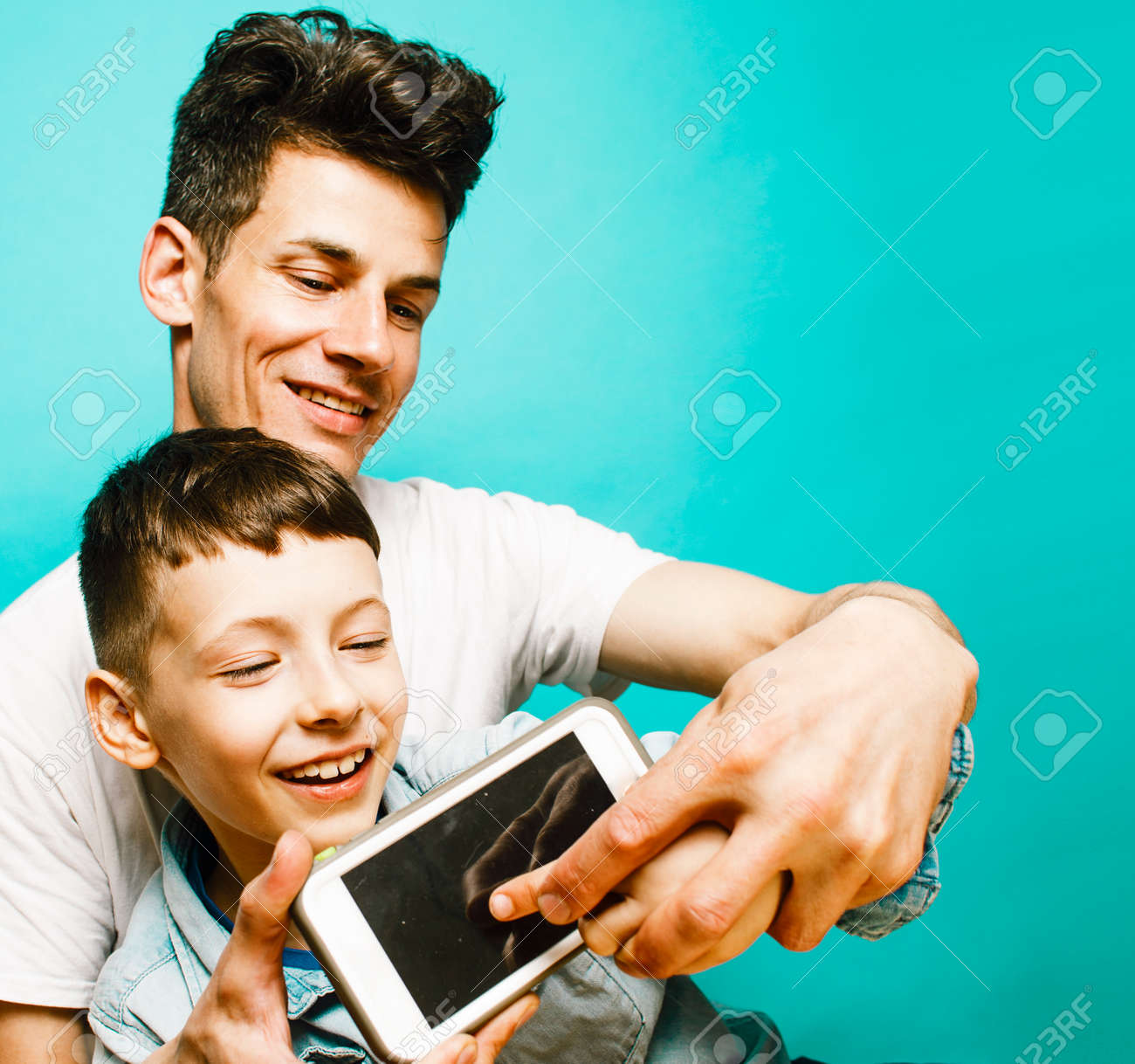 young pretty man model with little cute son playing together, lifestyle modern people concept, family male - 145368794