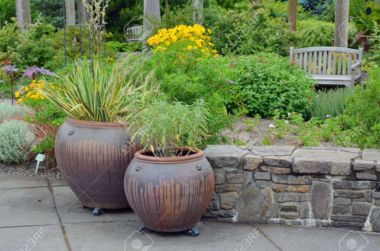 Two Ceramic Garden Pots On The Patio Stock Photo Picture And