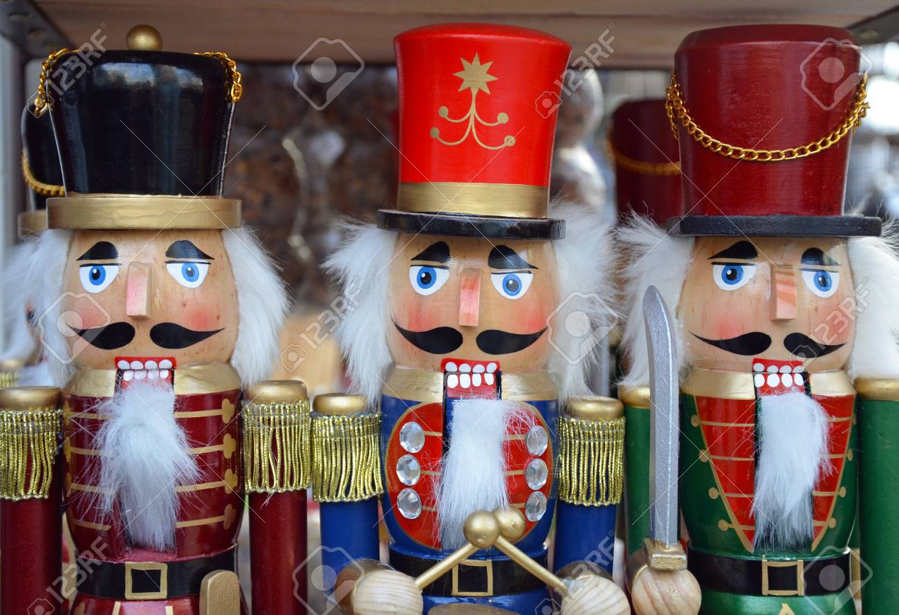 Three Colorful Wooden Christmas Nutcrackers On Display Stock Photo ...