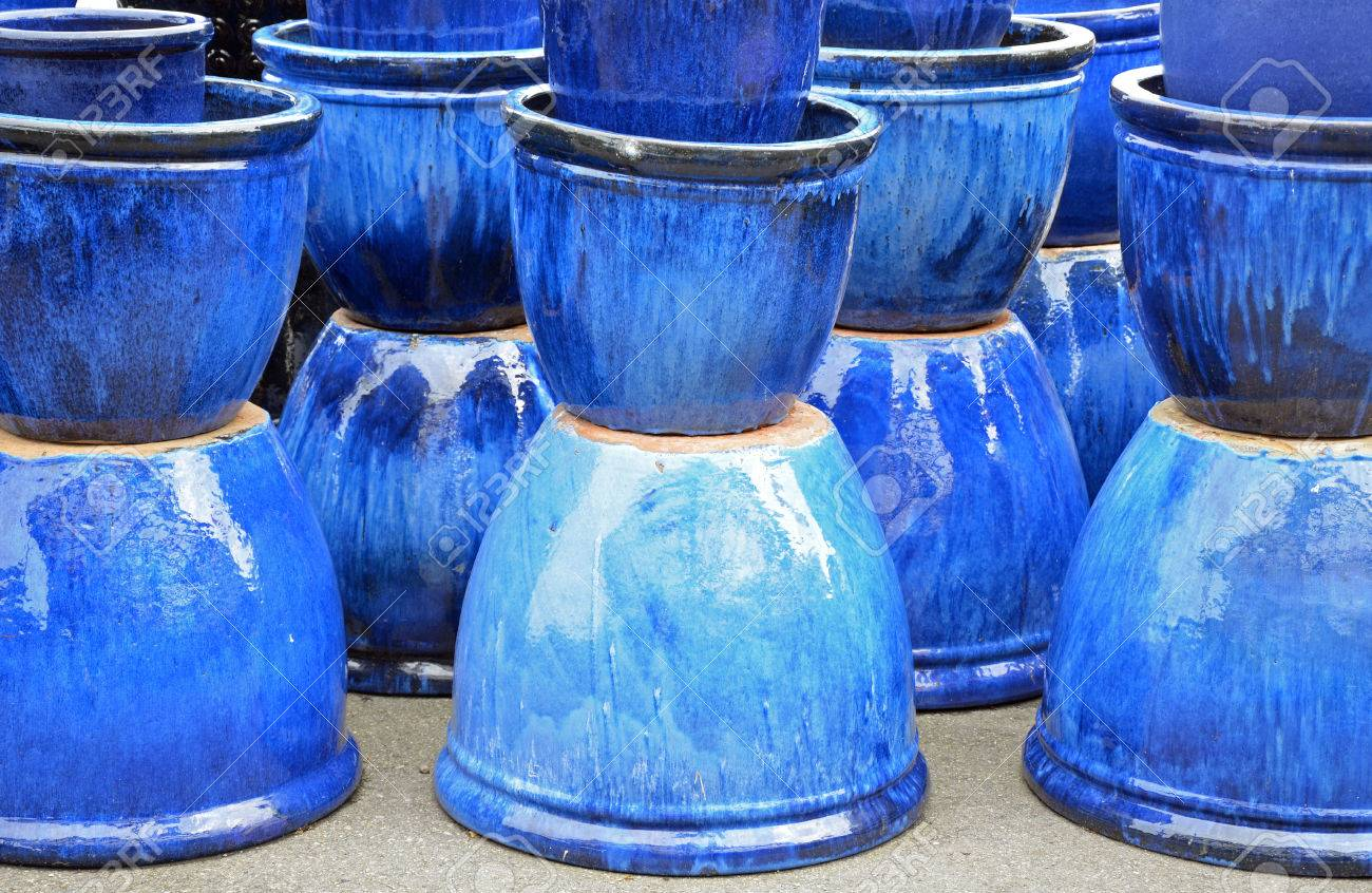 Blue glazed ceramic pots on display