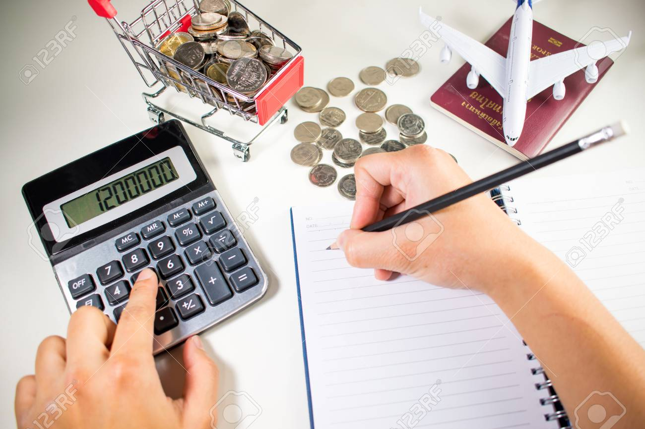 woman are calculating travel expenses asia thailand stock photo