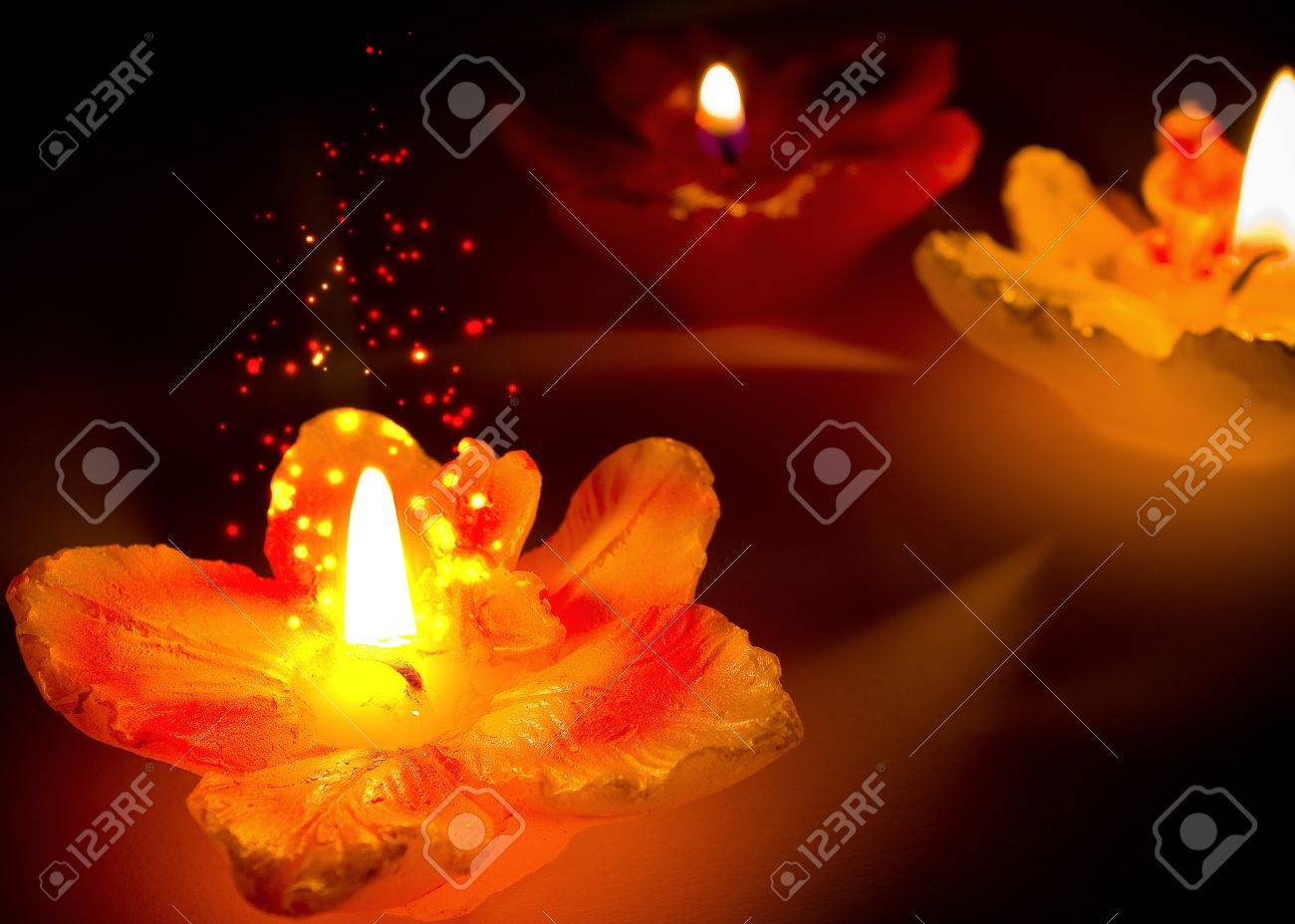 Three flower shape candles with sparks Stock Photo - 18085952