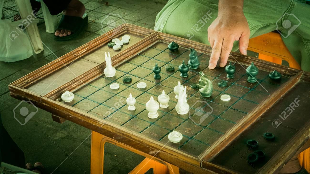 Unidentified old man is racing chess at Bangplat Bangkok , Thailand