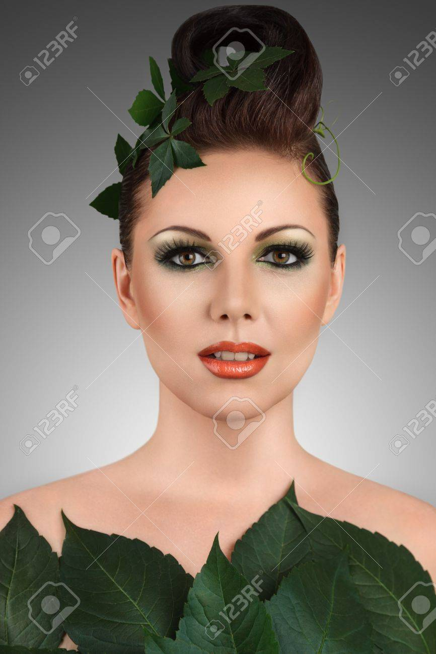Beautiful young woman with floral makeup and hairstyle studio portrait Stock Photo - 15408168