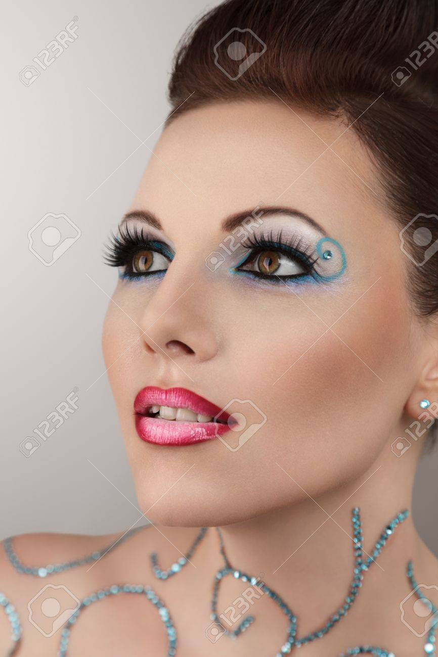 Beautiful young woman with floral makeup studio portrait Stock Photo - 15408157