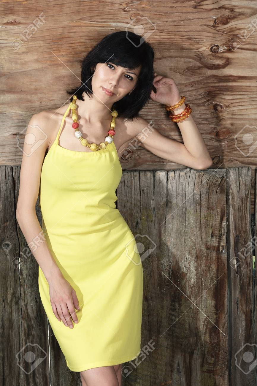Beautiful young woman in yellow dress outdoor portrait Stock Photo - 15408192