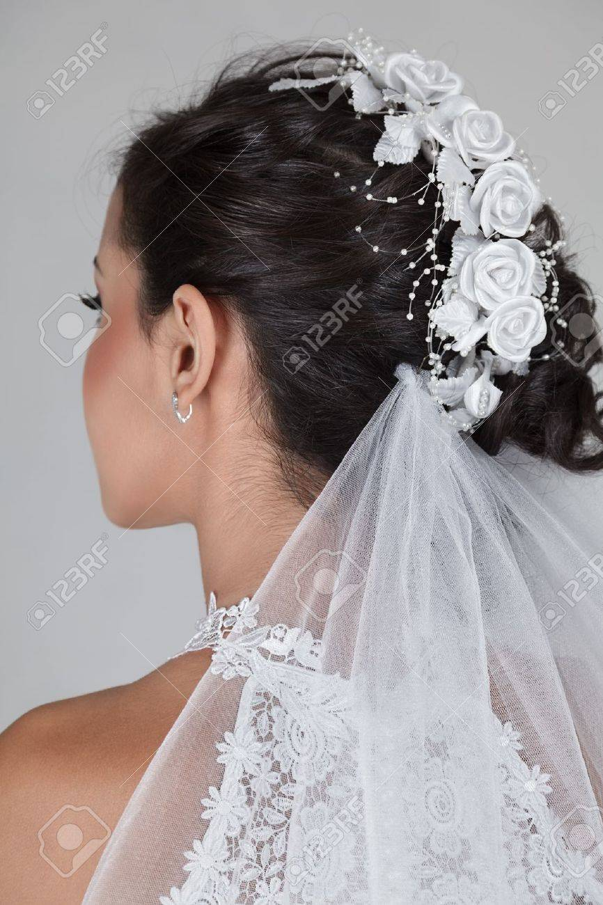 Young beautiful bride in wedding dress and luxury coiffure Stock Photo - 15408474