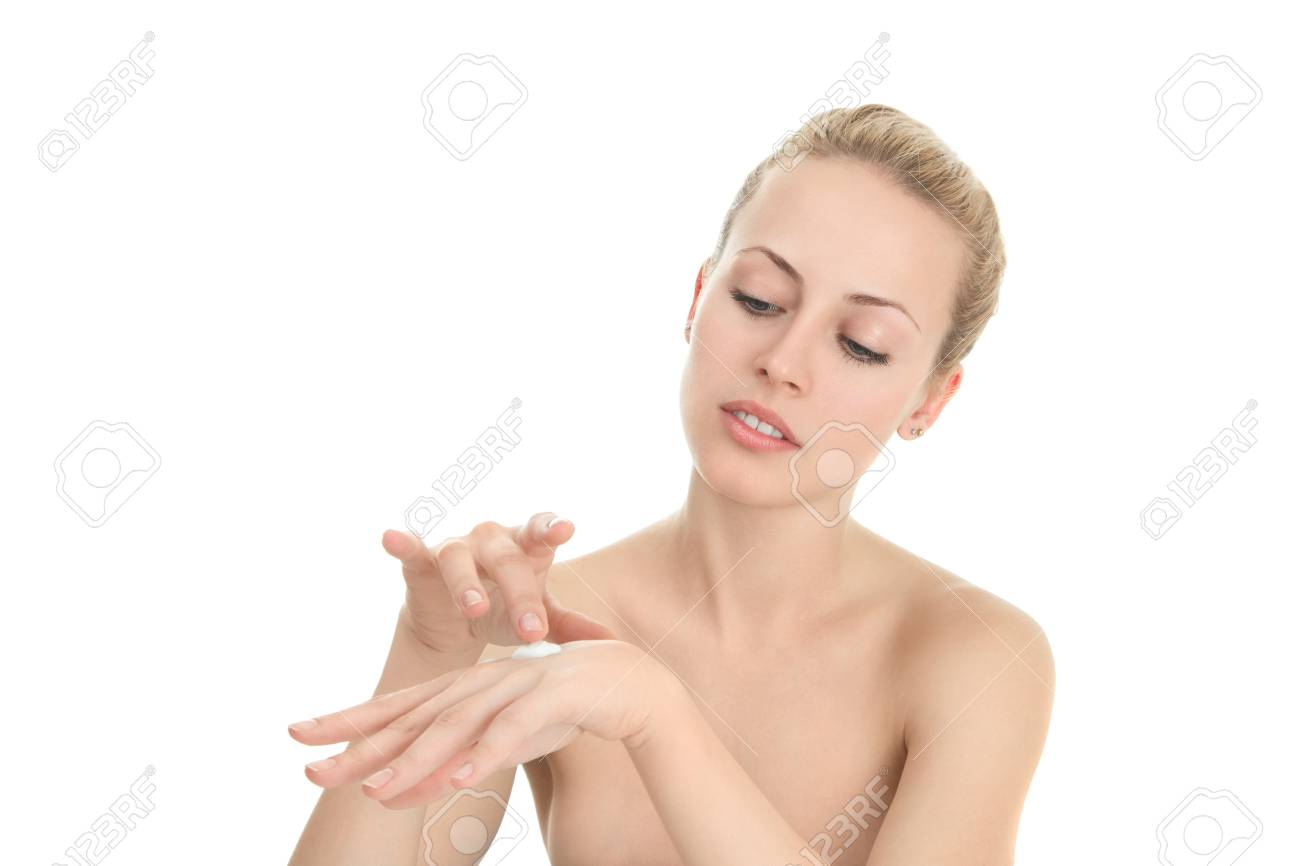 Young woman applying moistyring cream on hands Stock Photo - 15408270