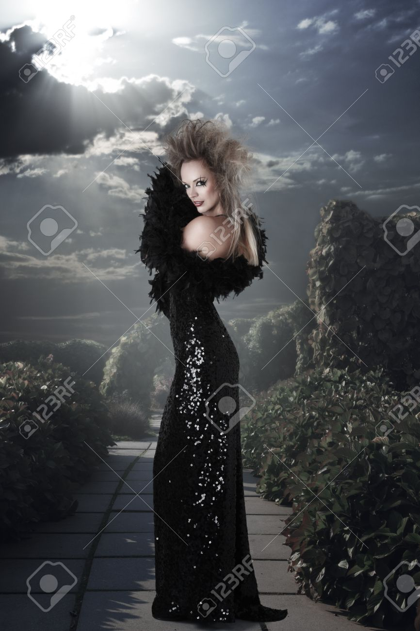Elegant woman in long black dress at mystic garden Stock Photo - 16289818