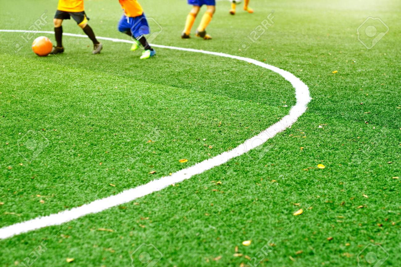 grass soccer field. Green Soccer Field Grass With White Mark Line And The Boys Play Football Background, Soft