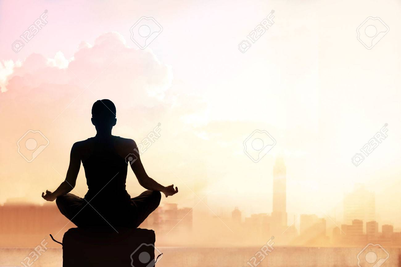 Abstract woman meditating on pastel color tone city in the sunset Standard-Bild - 54951512