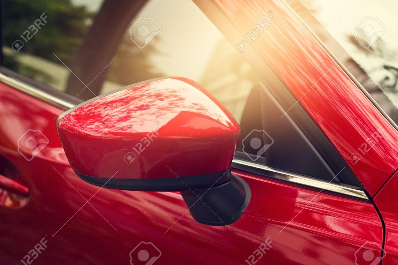 side rear-view mirror red car on street background Standard-Bild - 55377893
