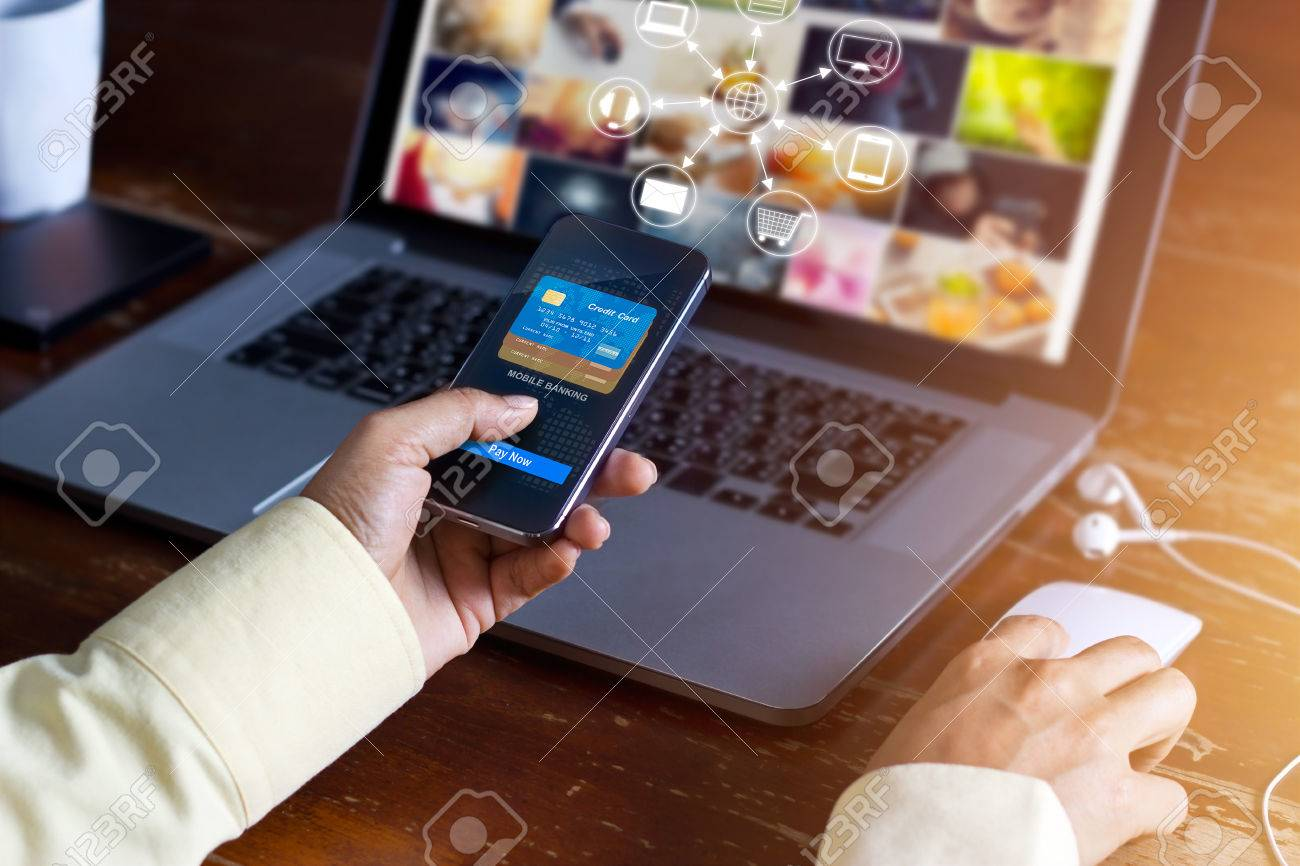 Man using mobile payments online shopping and icon customer network connection on screen, m-banking and omni channel Standard-Bild - 61706543
