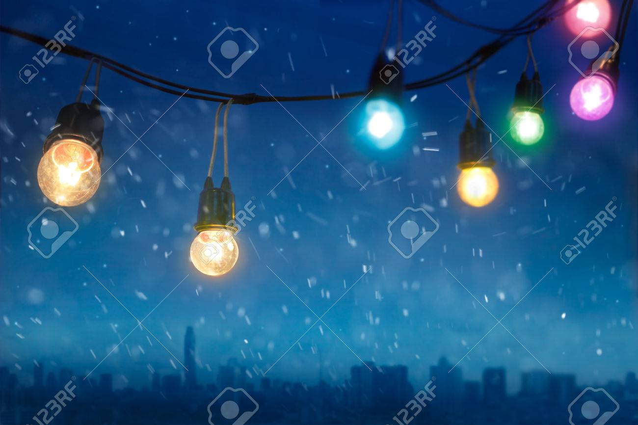 Colourful Glowing Christmas Lights In Snowfall On The Dark Blue ...