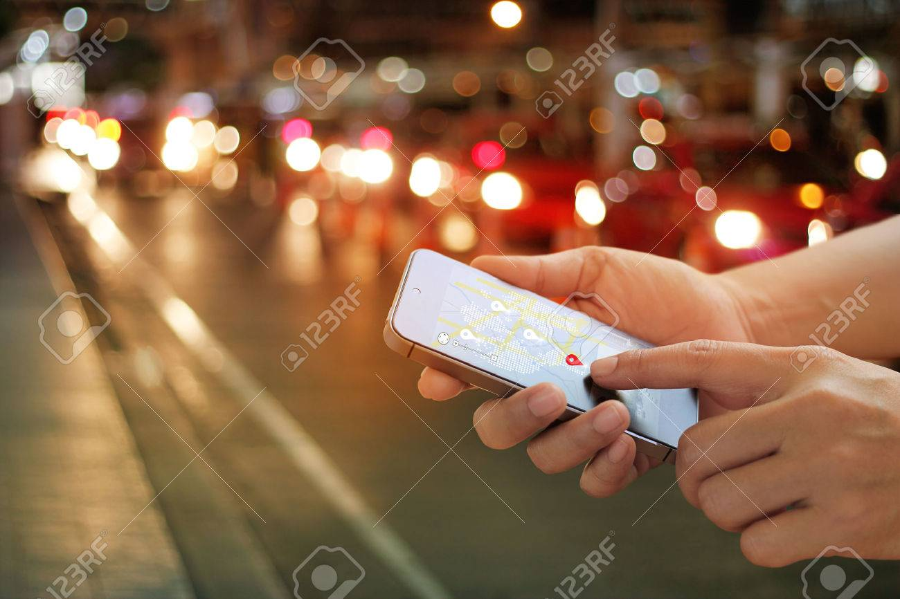 man using navigation app on the smartphone on street at night, all on mobile screen are designed up Standard-Bild - 69071164