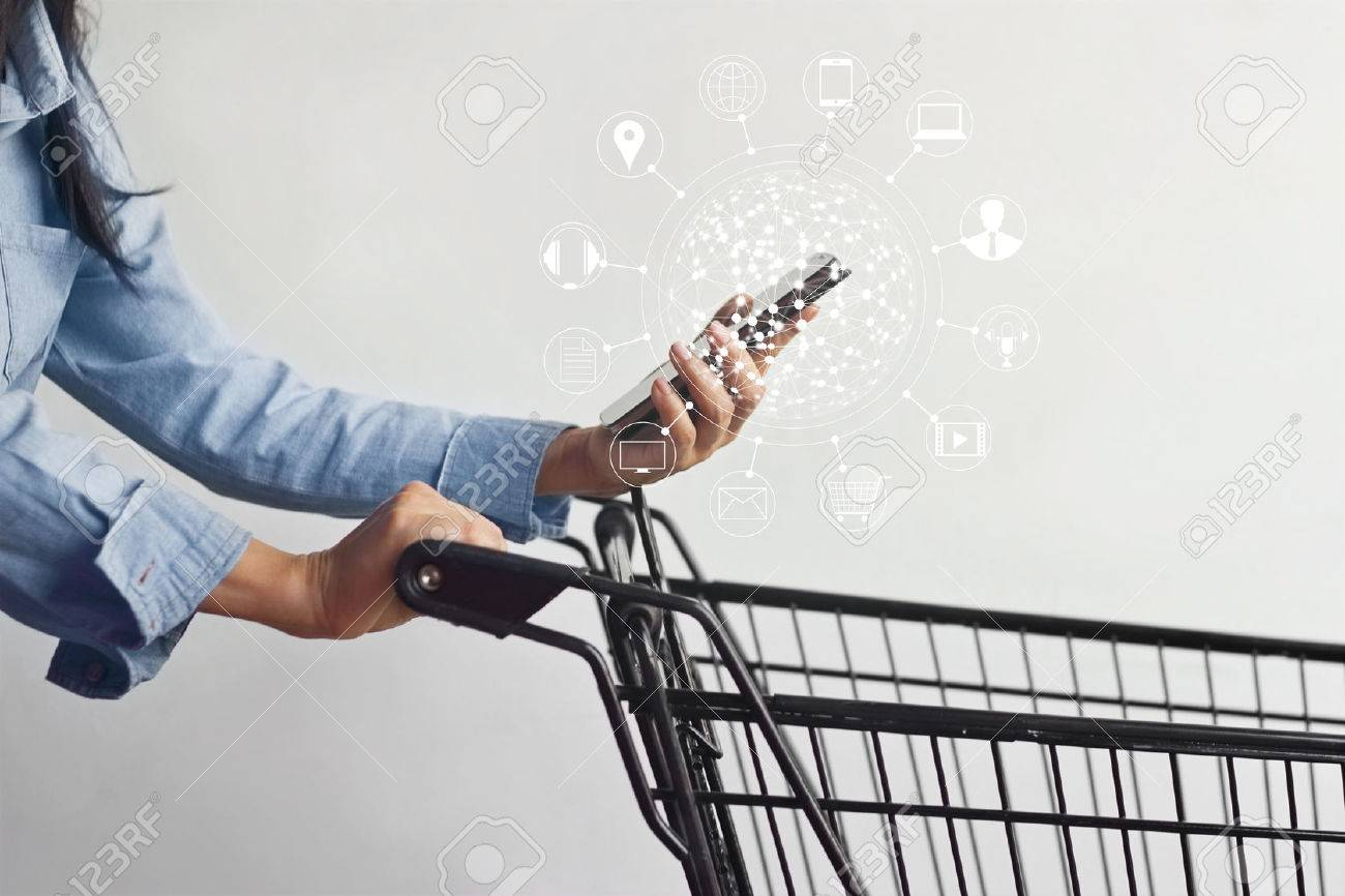 woman using mobile payments online shopping and icon customer network connection on screen, m-banking and omni channel Standard-Bild - 74434752