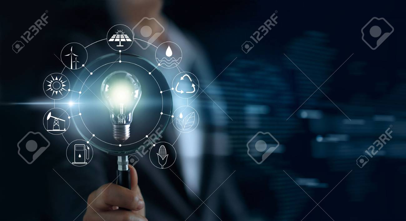 Man holding magnifying glass and light bulb ,search of global show the world's consumption with icons energy sources for renewable, sustainable development. Ecology concept - 87898505