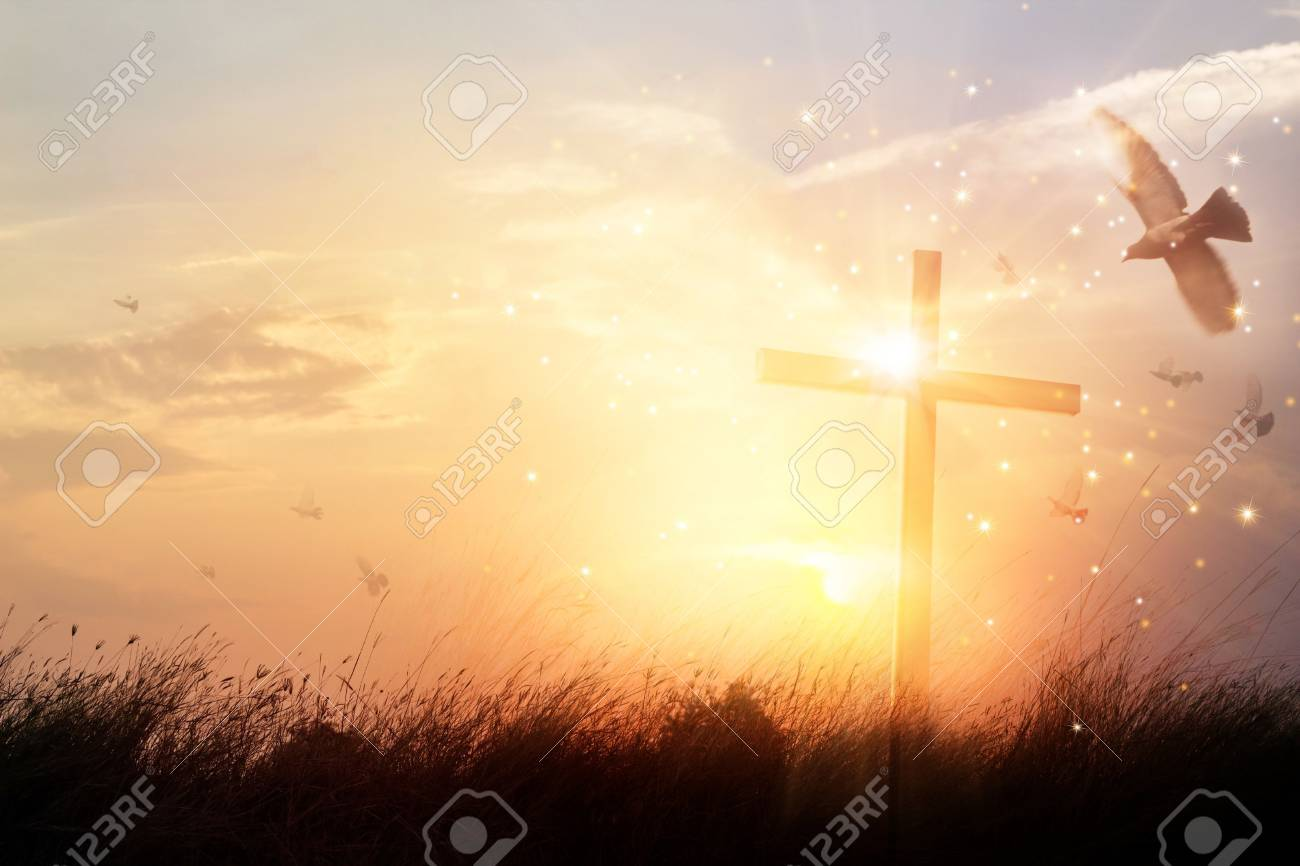 Silhouette christian cross on grass at sunrise background with miracle bright lighting, religion and worship concept - 106923777