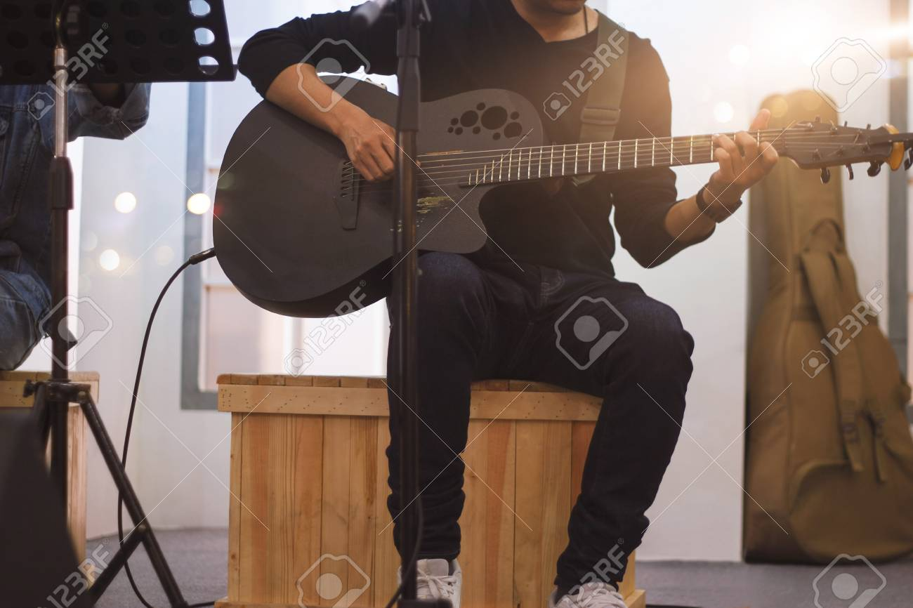 Guitarist on stage and sings at a concert for background, soft and blur concept - 109472569