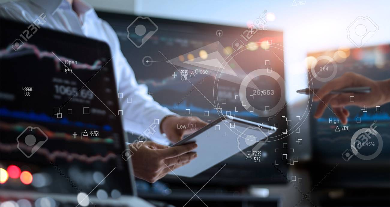 Business team working together. Businessman using tablet for analyzing data stock market in monitoring room with team pointing on the data presented in the chart on icon screen, forex trading graph, stock exchange trading online, financial investment concept. All on laptop screen are design up. - 119057680