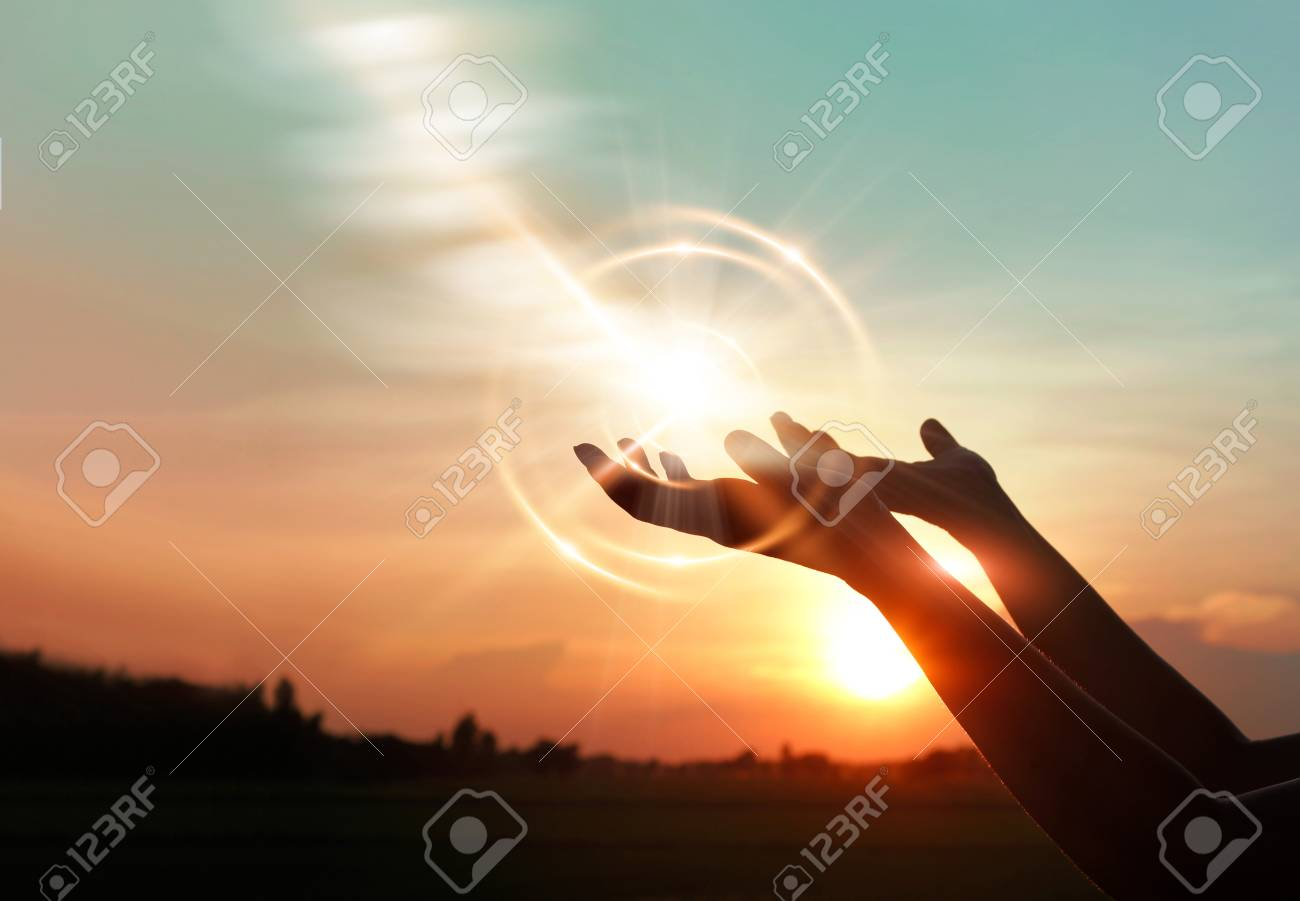 Woman hands praying for blessing from god on sunset background - 119057762
