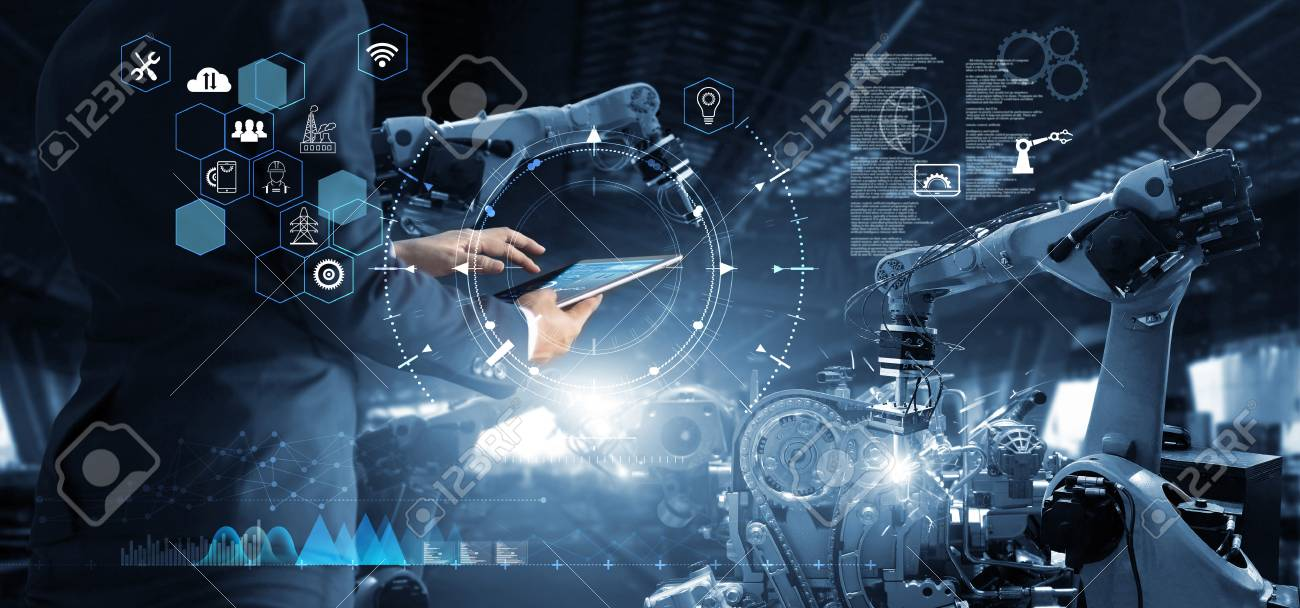 Manager Technical Industrial Engineer working and control robotics with monitoring system software and icon industry network connection on tablet. AI, Artificial Intelligence, Automation robot arm - 126271254