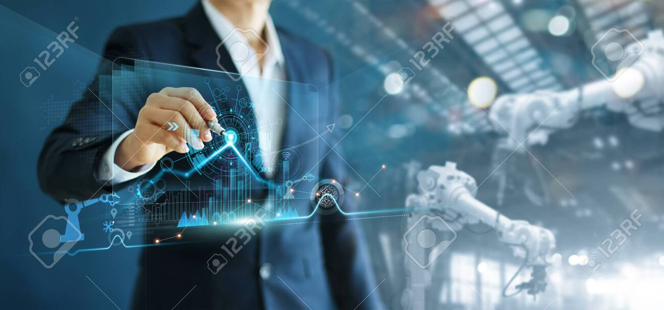 Manager engineer analyzing and control automation robot arms machine on software modern virtual interface data real time in intelligent factory industrial and digital manufacturing operation. - 132521299