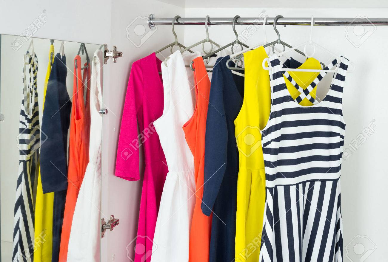 f761a04c316 a series of bright modern fashion women s dresses on hangers in a white  cupboard for summer