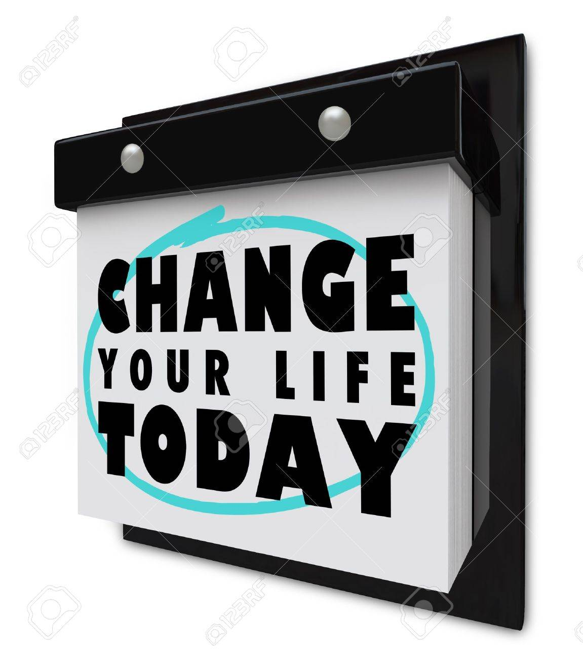 A wall calendar with tear-away pages, and words that read Change Your Life Today Stock Photo - 8893677