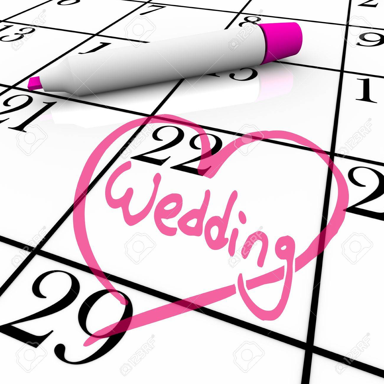 The date of a wedding is circled on a white calendar with a magenta colored marker, surrounded by a drawn heart Standard-Bild - 9029920