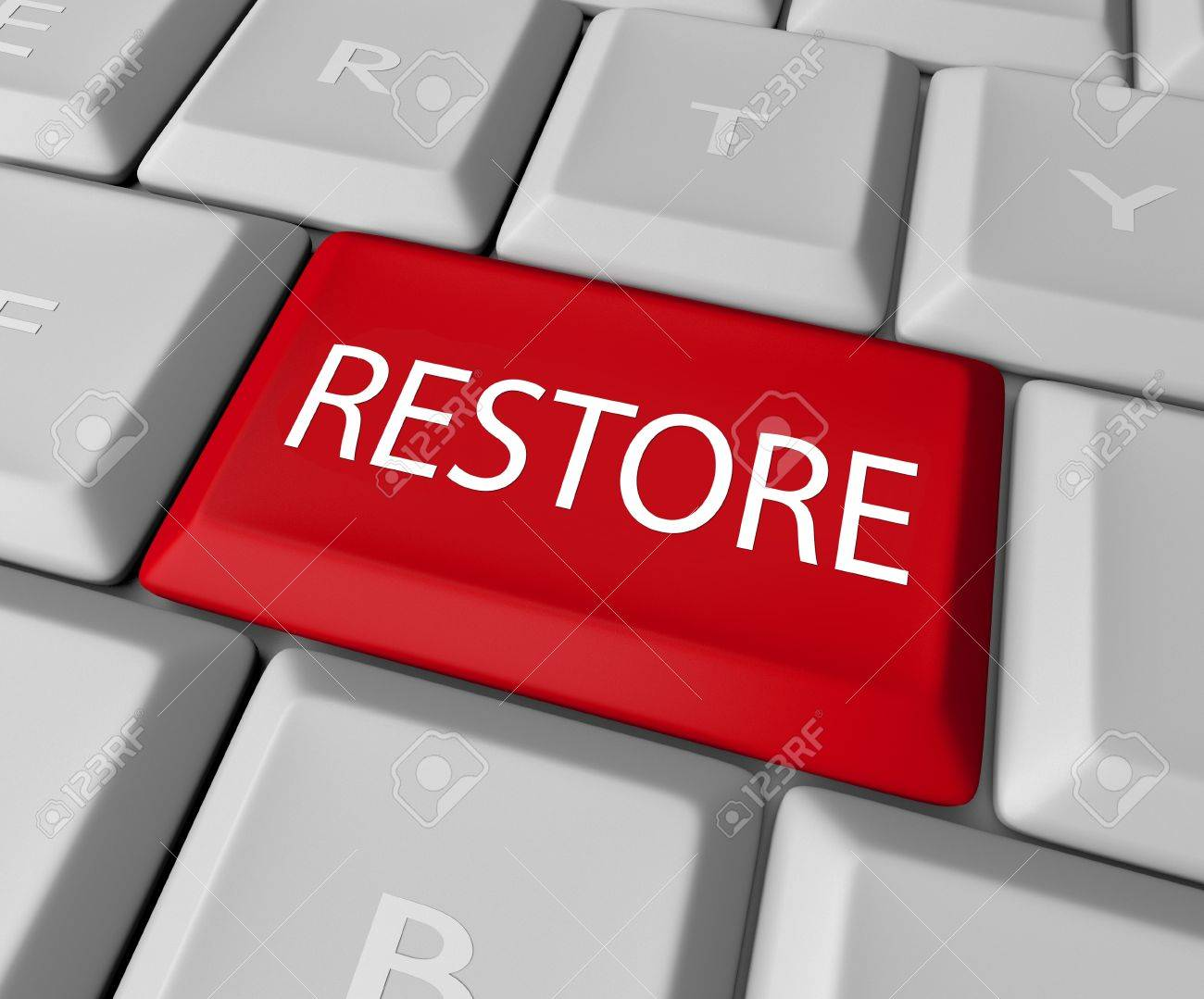 A keyboard with a red key for the word Restore, representing the need to return to past values or recover files lost on a computer through a back-up copy Stock Photo - 10978059