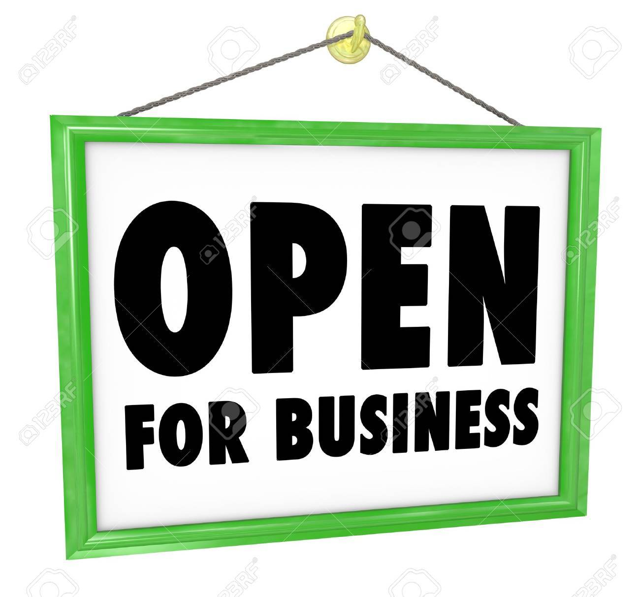 The words Open for Business on a sign that would hang on the wall or in a window of a shop, store or business to invite customers inside for a grand opening or for regular business hours Stock Photo - 15875813